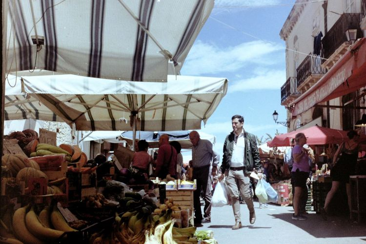 Taken with Lomo Smena 8M + Kodak Color Plus 200 film. Real People Incidental People Outdoors Walking Market Italian Market  Sicily Syracuse  Italian Food Italian Style Marketplace Market Vendor Market Stall Man Peple Travel Photography Food Fruit Vegetables Sunny Day City Day People Retail  Life Italian Lifestyle Leisure Activity Analogue Photography Film Photography Shopping Fresh Food Food Market Fruttivendolo Healthy Food The Traveler - 2019 EyeEm Awards