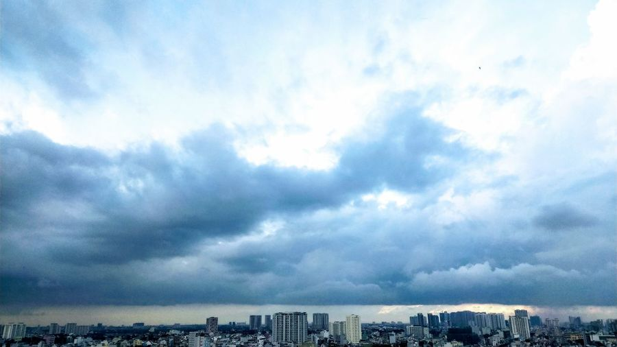 Aerial View Blue Overcast Cityscape Backlight Daylight Saigon Window View Panorama Skyline Outdoor Photography Outdoors Bird Sea Flying Sky Architecture Building Exterior Cloud - Sky Built Structure Dramatic Sky Overcast Atmospheric Mood Moody Sky Storm Cloud Meteorology Cloudscape Storm Sky Only