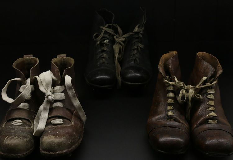 Close-up of shoes in darkroom