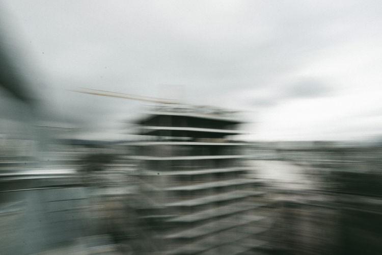 Blurred motion of wet shore against sky