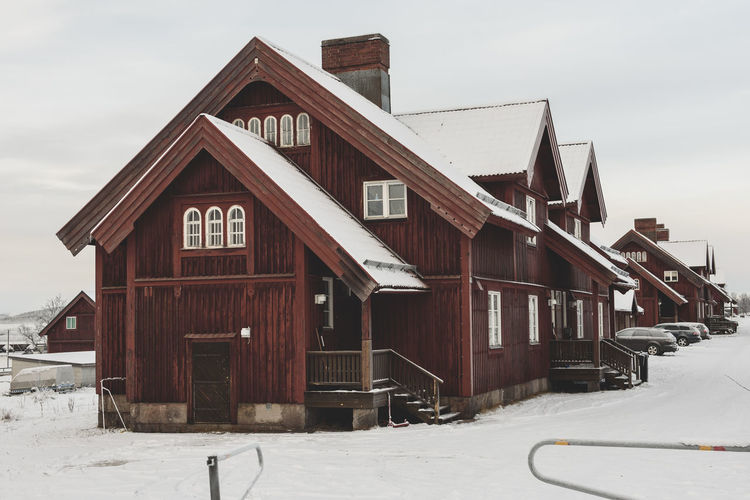 Red wooden house in Kiruna, Sweden. Scandinavian architecture. Kiruna Snow On Road Snow On Roof Sweden Winter Architecture Building Exterior Built Structure Cold Temperature House Kiruna Winter No People Outdoors Red House Red Wooden House Scandinavian Scandinavian Architecture Snow Snow On Rooftop Snowy Winter Winter Time
