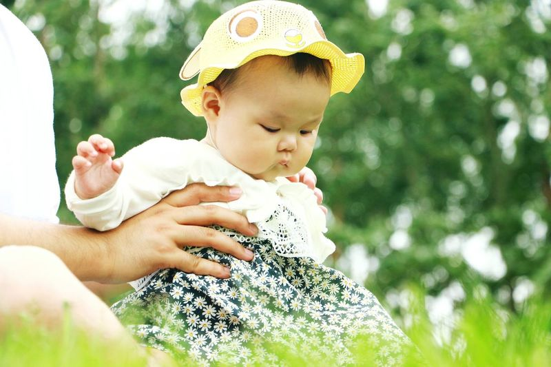 Baby Childhood People Holding Day Innocence One Person Cute Headshot Outdoors Child Babies Only Leisure Activity Close-up Playing Happiness Nature Human Body Part Adult Human Hand