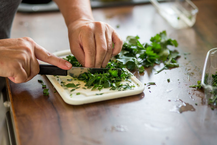 Cropped Cutting Cutting Board Food Food And Drink Freshness Holding Human Finger Kitchen Kitchen Utensils Parsley Person Selective Focus