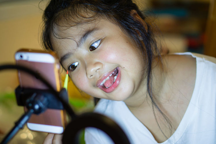 Portrait of cute girl using mobile phone