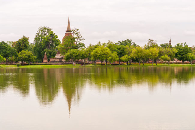 Pagoda Sukhothai Historical Park Sukhothaihistoricalpark Thailand Architecture Beauty In Nature Building Exterior Built Structure Day Lake Nature No People Outdoors Place Of Worship Reflection Religion Sky Spirituality Sukhothai Tree Water Waterfront