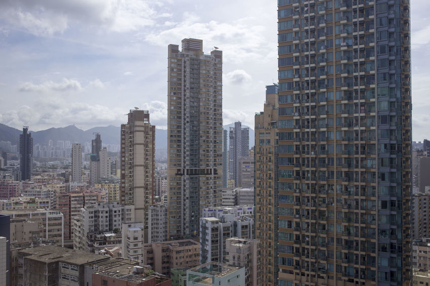 Hong Kong HongKong Apartment Architecture Building Building Exterior Built Structure City City Life Cityscape Cloud - Sky Day Financial District  Modern Nature No People Office Office Building Exterior Outdoors Sky Skyscraper Tall - High Tower Urban Skyline