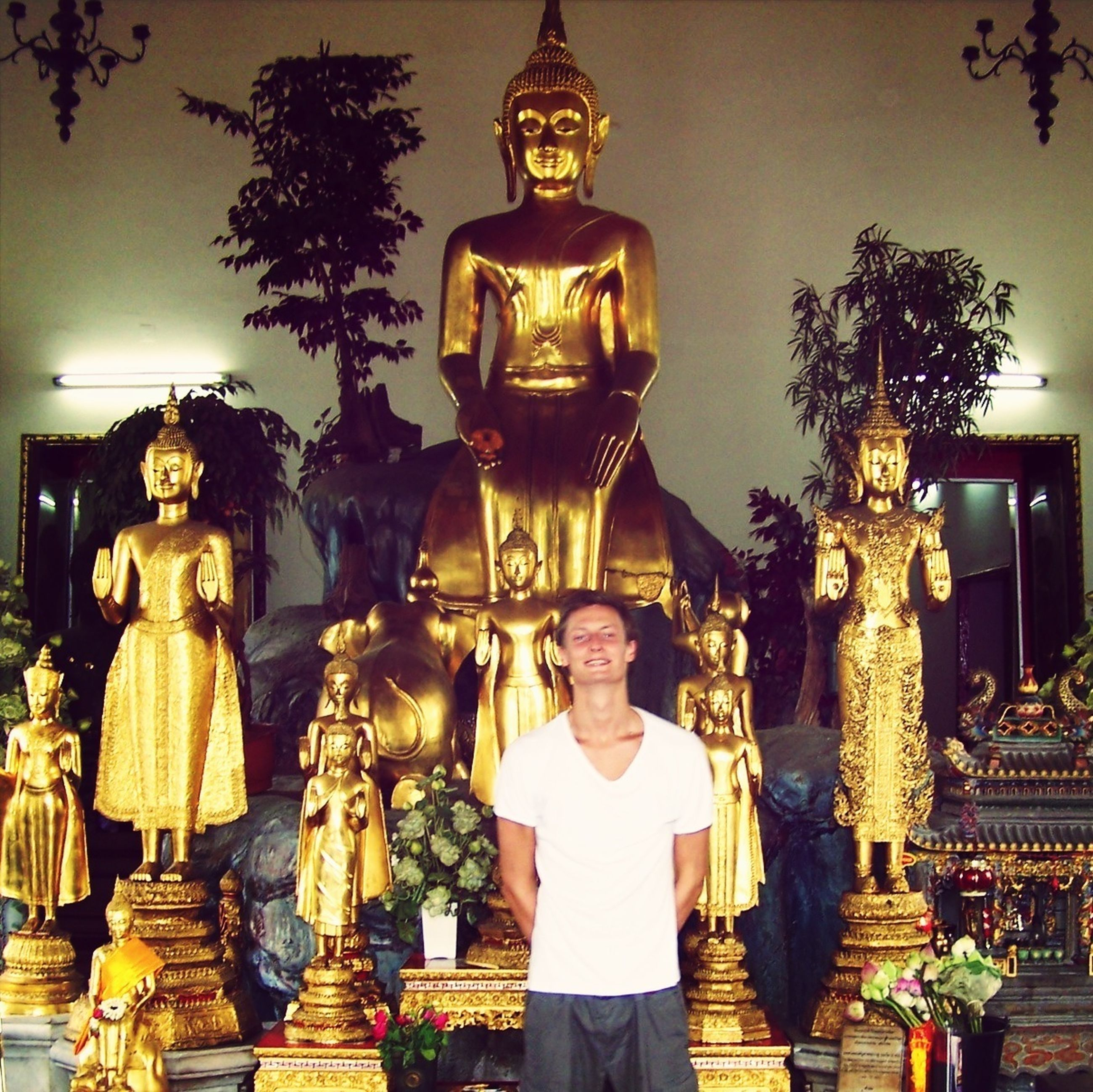 religion, spirituality, place of worship, illuminated, temple - building, buddha, lighting equipment, low angle view, human representation, statue, tradition, indoors, night, cultures, sculpture, lantern, decoration