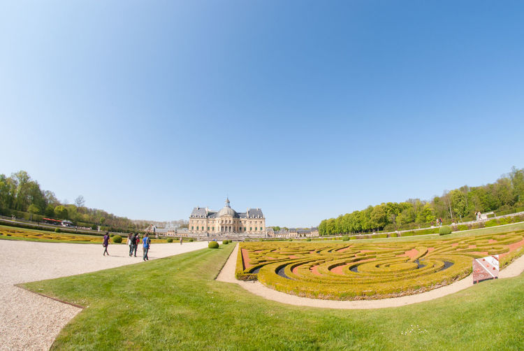 The Beautiful View Inside The Chateau De Vaux Le Vicomte Looking From It's Garden. The House Is A Baroque French Chateau Located In Maincy, Near Melun, 55 Kilometres Southeast Of Paris. Architecture Beautiful Building Exterior Built Structure Château Clear Sky Copy Space Day Europe France Grass History History Architecture Holiday Maincy Melun Outdoors Paris Sky Structure Tourism Travel Travel Destinations Tree Vicomte