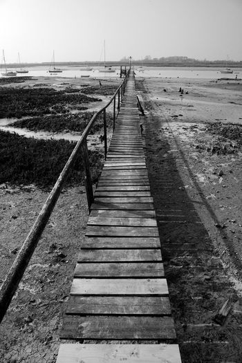 Rickety Jetty Architecture Blackandwhite Built Structure Diminishing Perspective Direction Pier Sea The Way Forward Transportation Water Wood Wood - Material