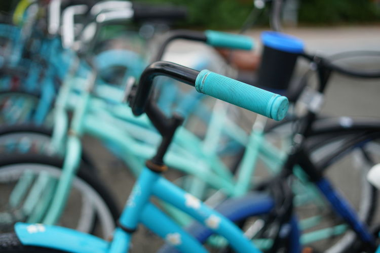 Close-up of bicycle in row