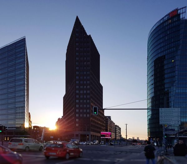 AntiM Bahntower Forum Tower Kolhoff Tower The Graphic City Architecture Building Exterior Built Structure Car City City Life Clear Sky Day Low Angle View Modern No People Outdoors Potsdamer Platz Sky Skyscraper Sunset Tall - High Tower Travel Destinations Urban Skyline
