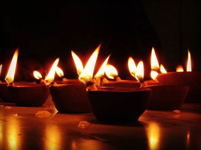 Diya Light Lights Flame Lightning Diwali Diwali2015 Canon Canon_official Canon_photos Insta Reflection Pic Picture Pictureoftheday Pictures Flames Saynotocrackers Family Candle Candles Candlelight Heat