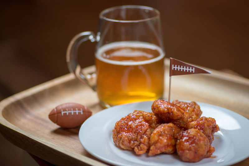 Beer Buffalo Football Hot Wings Tray Big Game Boneless Close-up Day Drink Food Food And Drink Freshness Game Glass Mug Indoors  Mug No People Plate Ready-to-eat Refreshment Snacks Still Life Table Wings