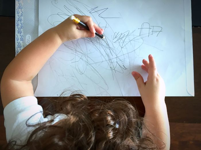 High Angle View Of Child Drawing