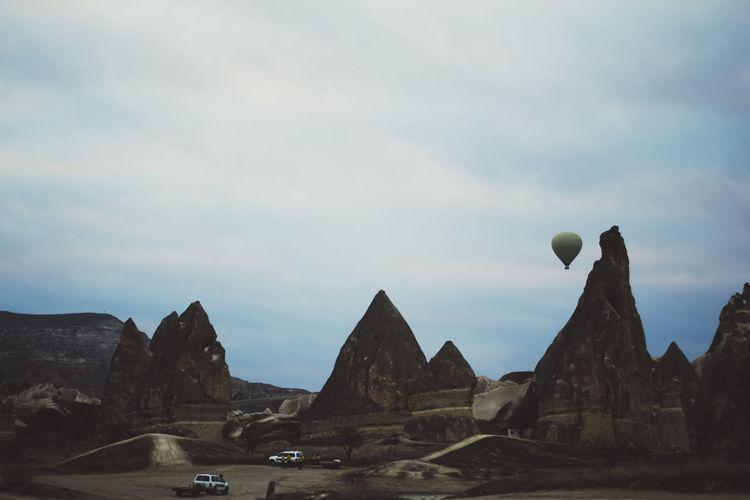 Hot air balloon over cappadocia rock landscape
