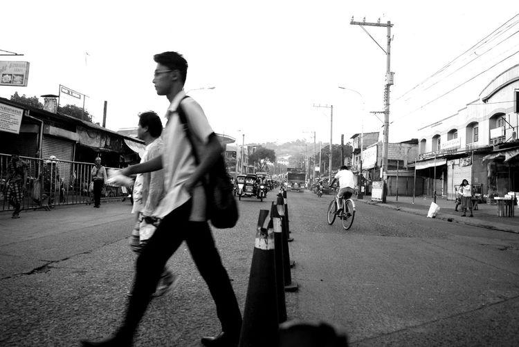 Men on city street against sky