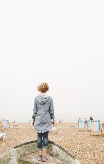 Beach Blonde Brighton Casual Clothing Clear Sky Curly Hair Day Foggy Full Length Girl Leisure Activity Lifestyles Nature Outdoors Rear View Scenics Sky Standing Tranquil Scene Tranquility People And Places Connected By Travel It's About The Journey