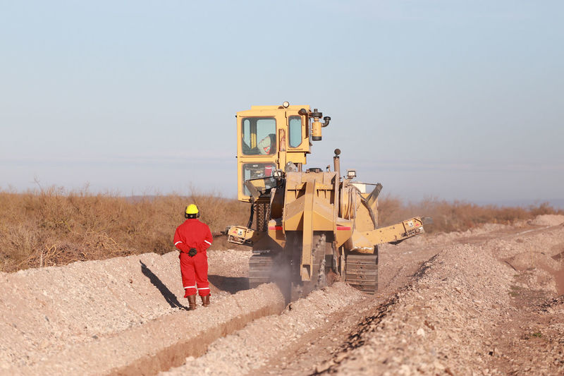 Trencher Day Ditch Heavy Equipment Heavy Machine Heavy Machinery Industrial Industry Machine Oil&gas Outdoors Petrol Remote Sky Trencor Unrecognizable People Unrecognizable Person Work Working