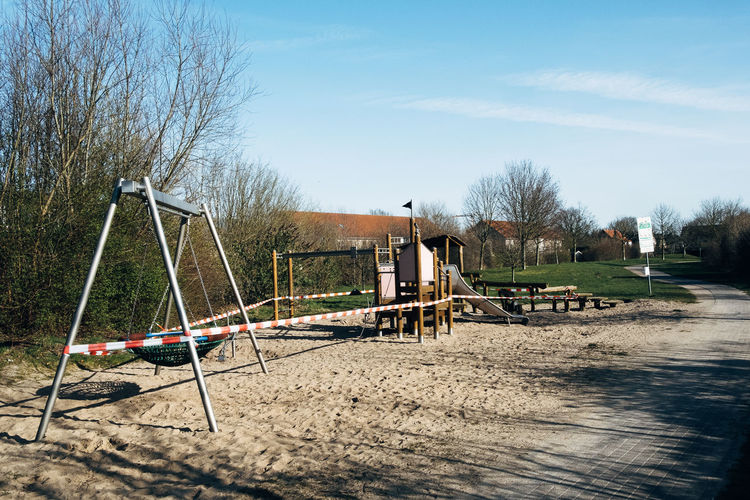 View of playground in park against sky