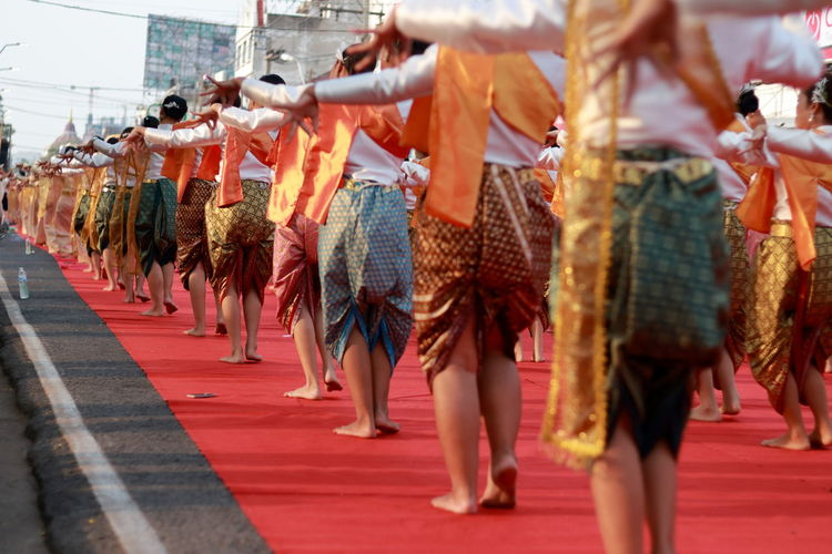 Rear view of women wearing traditional clothing while dancing outdoors