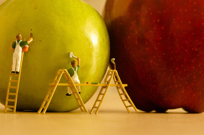 Playmobil People next to Apples Fruit Food And Drink Healthy Eating Apple - Fruit Food Still Life Wellbeing Indoors  Red No People Close-up Freshness Table Yellow Choice Studio Shot Pear Healthy Lifestyle Group Of Objects Focus On Foreground
