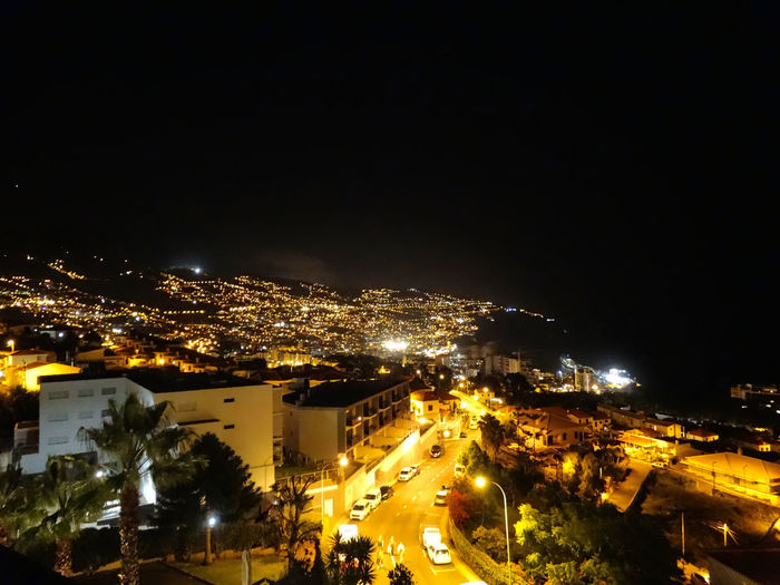 Night scene in Madeira. City Night Illuminated Architecture Building Exterior Built Structure Cityscape High Angle View Building No People Street Copy Space Residential District Nature Outdoors Sky City Life Tree Madeira Madeira Island City Scene Night Lights Night Life Lights darkness and light Darkness Dark Sky Night Sky Road Transportation Hotel