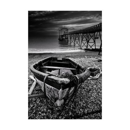 Selsey RNLI station... and rowboat Beach Monochrome Blackandwhite Canon650d No People Pebbles Abandoned RNLI Sussex Moody Sky Sea Pier Seaside Day Water