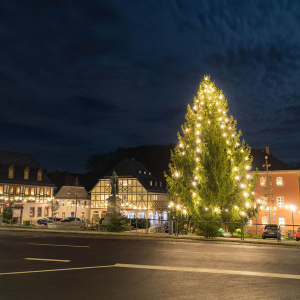 lighted christmas tree in a small town in germany Christmas Lights No Snow In Winter Winter Architecture Building Celebration Christmas Christmas Light christmas tree City Illuminated Night No People Road Sky Street Town Tree