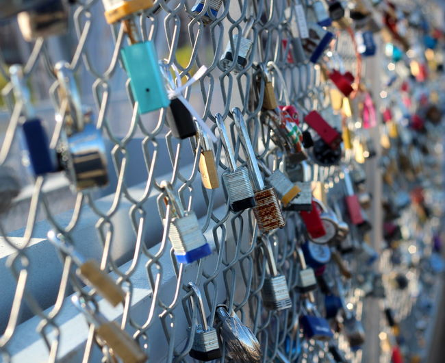 Abundance Barrier Boundary Chainlink Fence Choice Day Fence Hanging Large Group Of Objects Lock Love Love Lock Metal No People Outdoors Padlock Positive Emotion Protection Safety Security Selective Focus Variation