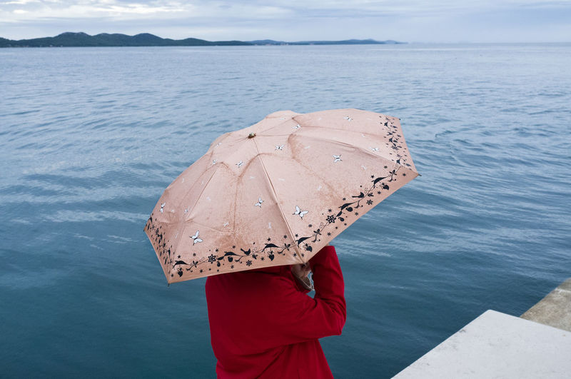 At the promenade in Zadar, Croatia Adriatic Balkan Balkans Butterflies Croatia Horizon Horizon Over Water Island Melancholic Landscapes Melancholy One Person Only Women Outdoors Sea Sea Organ Silence Sky Street Photography Streetphoto Streetphoto_color Streetphotography Travel Photography Umbrella Under Umbrella Zadar