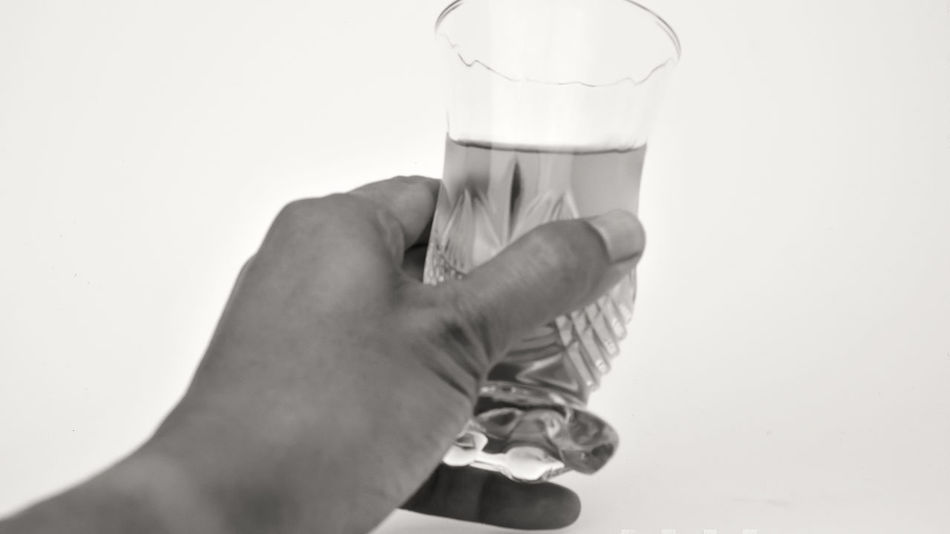 male hand holding a glass, white background, b&w mode Adult Close-up Day Drink Drinking Glass Drinking Water Food And Drink Freshness Healthy Eating Healthy Lifestyle Holding Human Body Part Human Hand Indoors  Milk One Person People Refreshment Water White Background