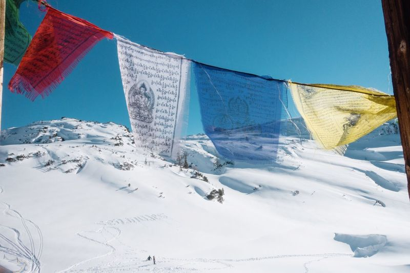 Above... Colorful Spirit Budism Snow Winter Nature No People Cold Temperature Blue Day Sky Clear Sky Sunlight Tranquility Low Angle View Environment White Color Beauty In Nature Flag Tranquil Scene Snowcapped Mountain Outdoors Mountain