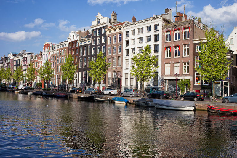 Old houses along Singel canal in Amsterdam, Holland, Netherlands Amsterdam European  Houses Netherlands Row House The Netherlands Architecture Boat Boats Building Exterior Built Structure Canal Capital City City Dutch Europe Holland House Nautical Vessel Old Buildings Old House Residential Building Singel Water Waterfront