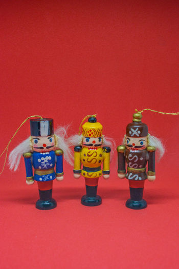 Nutcracker Nutcrackers Childhood Close-up Colored Background Day Doll Female Likeness Friendship Human Representation Indoors  Large Group Of Objects No People Studio Shot Togetherness