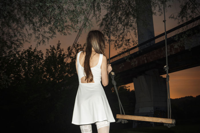 I've been waiting for you the whole week. It's time to play Fashion Linas Was Here Under The Bridge White Dress Brunette Girl  Evening Leaves Model Summer Sunset Swings Urban Wonderful Sky Urban Fashion Jungle #urbanana: The Urban Playground