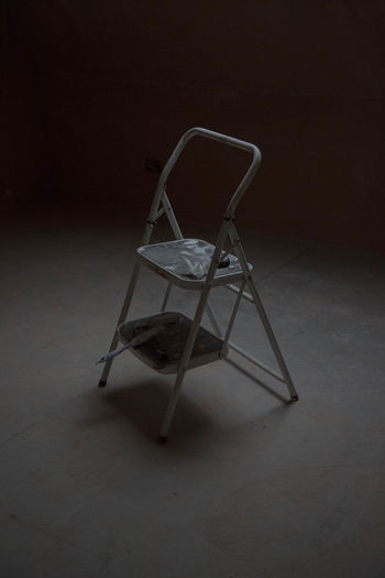 Abandoned Absence Balance Chair Dark Depression - Sadness Domestic Room Empty Flooring Furniture Home Interior Indoors  Metal Minimal No People Old Seat Shadow Single Object Still Life Table Wall - Building Feature