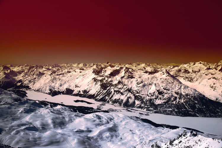 A view of fantastic colorized mountains in the switzerland Beauty In Nature Scenics - Nature Sky Winter Nature Snow Mountain Cold Temperature Sunset Tranquility Tranquil Scene Environment No People Water Mountain Range Remote Motion Idyllic Non-urban Scene Snowcapped Mountain Outdoors