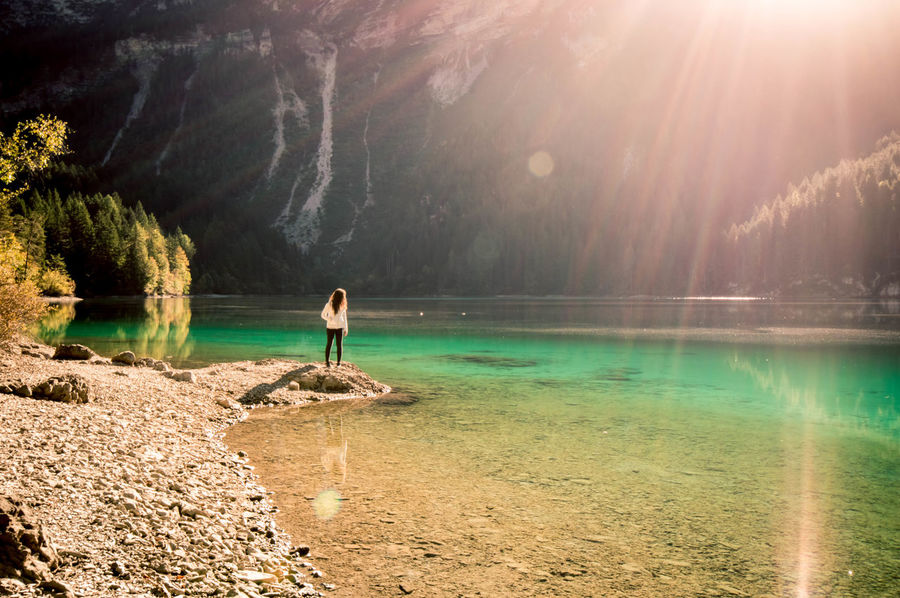 Sunlight and green. Water Sunbeam Full Length Standing Tree Tranquil Scene Lens Flare Lake Scenics Nature Solitude Beauty In Nature Day Sun Outdoors Green Landscape Sunlight Trentino  Trentino Alto Adige