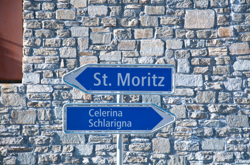 Blue Brick Wall Celerina Close-up Communication Day Directional Sign Information Information Sign No People Outdoors Road Sign Saint Moritz Suisse  Text Western Script