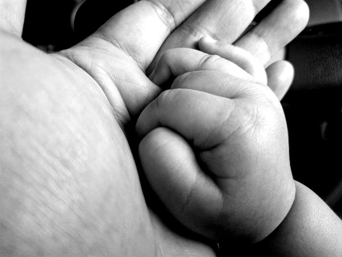 Your hand in mine. Human Body Part Two People Men Togetherness Human Hand Adult People Gripping Close-up Couple - Relationship Bonding Indoors  Day Baby Holding Baby Hand