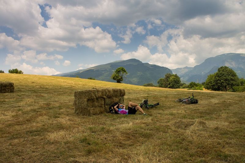 Man Relaxing On A Hill In Summer