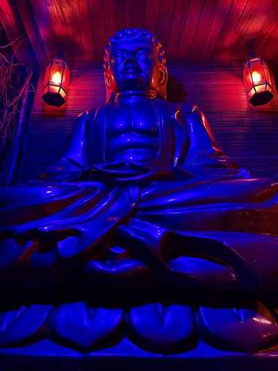 Statue of illuminated buddha in temple
