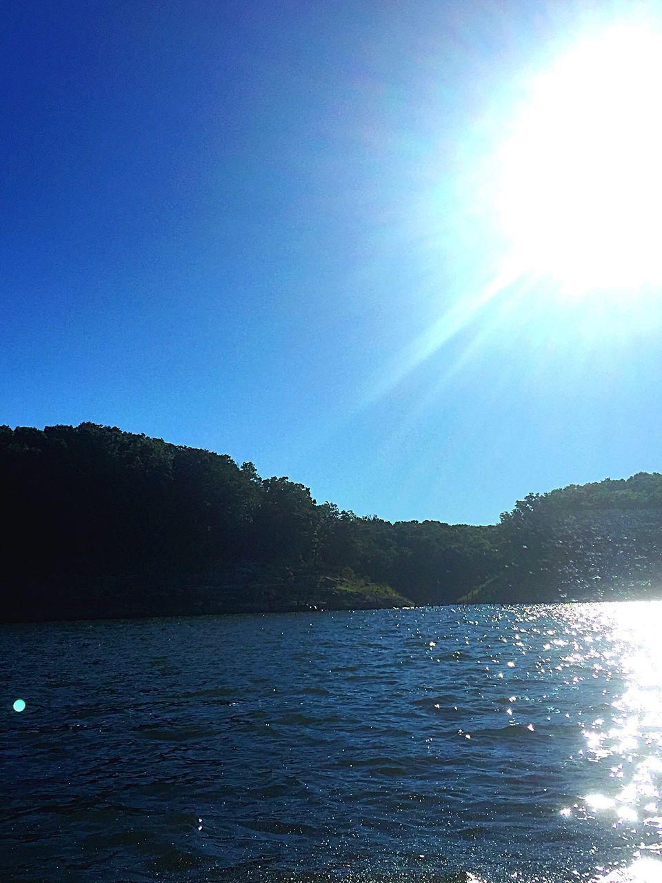 nature, sunlight, blue, water, beauty in nature, tranquility, outdoors, scenics, tranquil scene, sea, no people, sky, day, tree