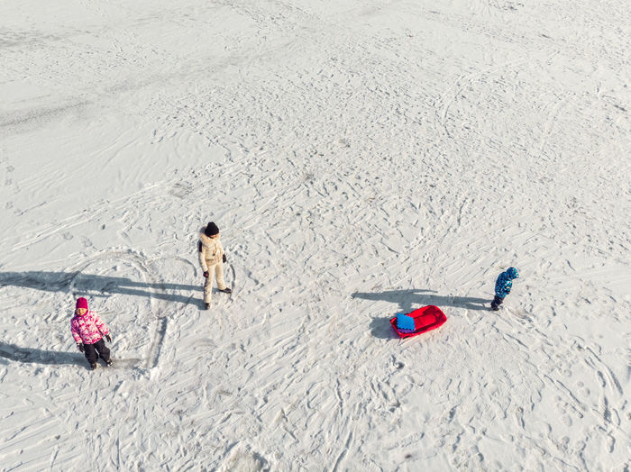 High angle view of people playing on sand at beach