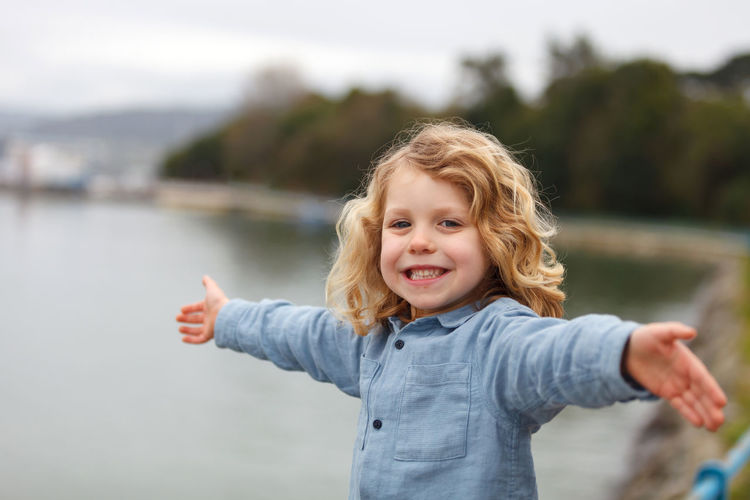 Portrait of smiling girl standing in water
