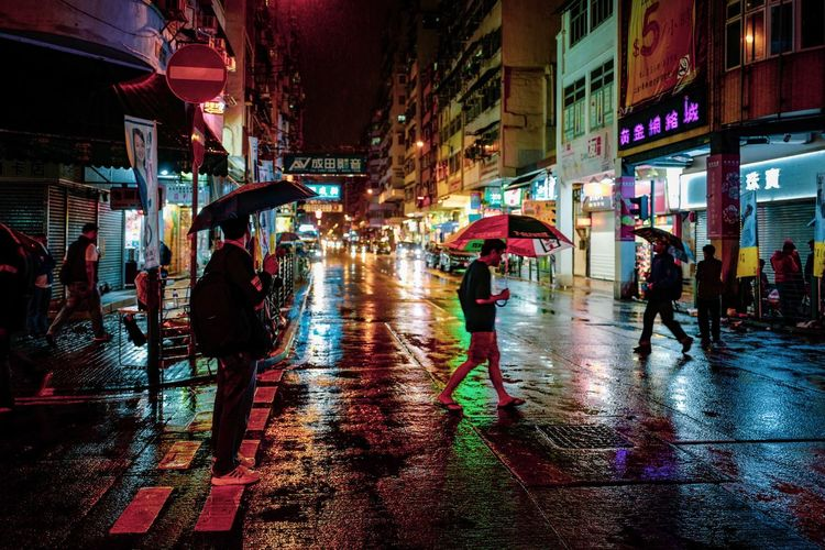 Street Photography Rain Night Rain Discoverhongkong Reframinghk City Wet Street Architecture Illuminated Building Exterior Rain Transportation Night City Life Real People Group Of People Umbrella Built Structure City Street Walking Protection Women Road Rainy Season