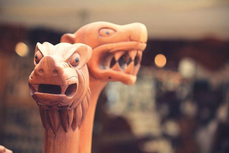 Close-up of wooden dragon sculptures