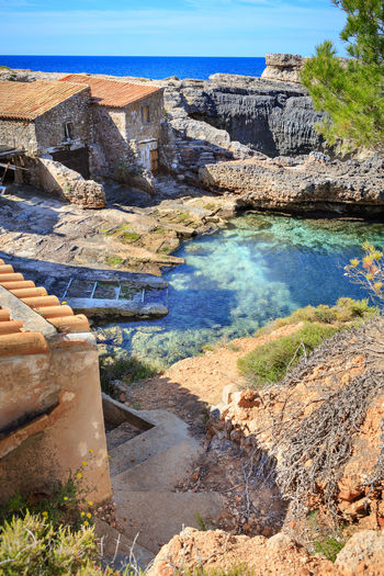 The coast of Mallorca Island, the Balearic Islands in the Mediterranean Sea, Spain Balearic Islands, Balearics, Mediterranean, Southern, Beach, Coast, Europe, Holiday, Mallorca, Outdoor, Palm Tree, Paradise, Relax, Sand, Sea, Seascape, Spain, Summer, Tourism, Travel, Tropical, Water Beauty In Nature Day Mining Nature No People Outdoors Rock - Object Scenics Sky Water