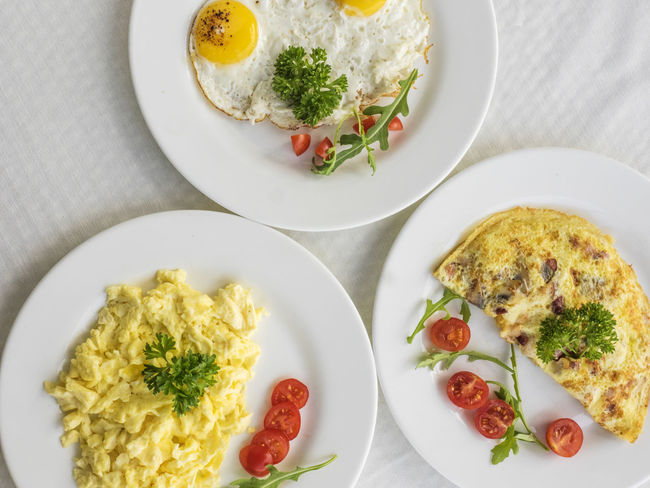 Omelets and frying eggs on the table Breakfast Frying Breakfast Close-up Day Egg Egg Yolk Eggs Food Food And Drink Freshness Fried Egg Healthy Eating High Angle View Indoors  No People Omelet Plate Ready-to-eat Table Yolk
