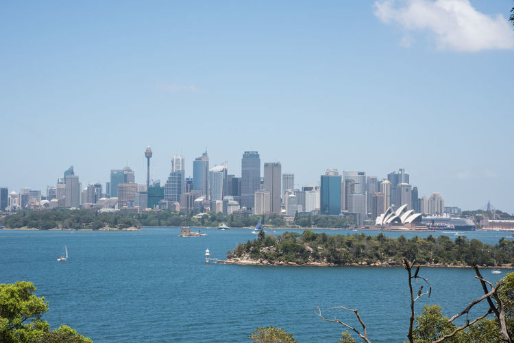 Sydney, New South Wales/Australia-December 21,2016: View over the urban skyline with Sydney Opera House and harbour in Sydney, Australia Architecture City Cityscape Nature Water Parramatta River Skyline Sydney Landmark New Shoes Skyscraper Office Building Exterior Modern Urban Skyline Building Exterior Tower Sydney Opera House International Landmark Sydney Eye Tower Sailboat Transportation Fort Denison Landscape Growth Outdoors